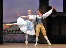 Martin Harvey as Colas in La Fille mal gardee, dancing here with Sarah Lamb.jpg